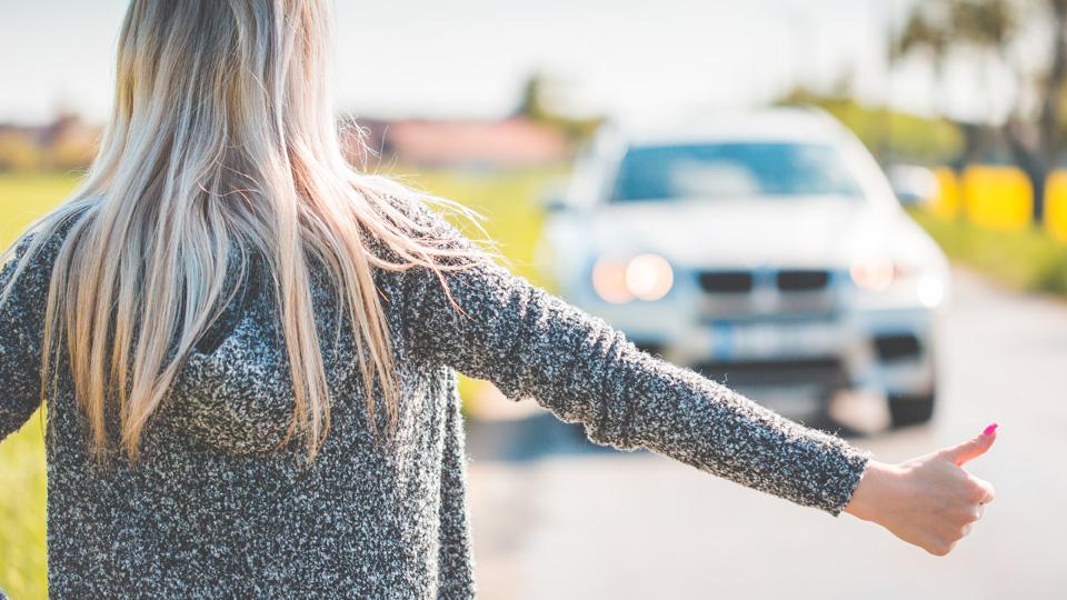 Blonde Woman Hitchhiking Because of Her Broken Car